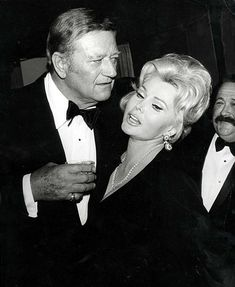 Hollywood, California, USA March, American film stars John Wayne and Zsa Zsa Gabor at the Hollywood Palladium at the annual Grammy Award presentation, held by the National Academy of recording Arts and Sciences. Hollywood California, California Usa, Gabor Sisters, Zsa Zsa Gabor, John Wayne Movies, Agnes Moorehead, The Searchers, Anti Smoking, National Academy