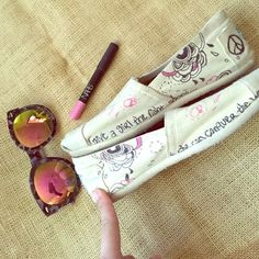 "TOMS custom hand drawn size 7.5 Adorable Toms - custom hand drawn designs with quote ""give a girl the right shoes and she can conquer the world"" - gently worn - size 7.5 - cream/off white colored with pink and black designs TOMS Shoes Flats & Loafers"