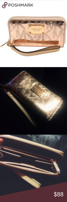 NWOT Michael Kors Rose Gold Leather Wristlet Brand new, never used Michael Kors rose gold leather wristlet. Ideal to carry your cell phone, cards, cash, etc.! Michael Kors Bags Clutches & Wristlets