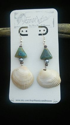 Check out this item in my Etsy shop https://www.etsy.com/listing/212090841/shell-earrings-with-beautiful-bead