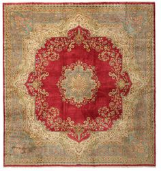This carpets shows and demonstrates the master craftsmanship of the Kerman weaver. The carpet has a very detailed floral border and center medallion set on a red field. Carpet available from CarpetVista.com collectible carpets.