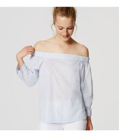 In crisp cotton, the classic button down gets a summer refresh with an off-the-shoulder neckline - and an unexpected buttoned back. Elasticized off-the-shoulder neckline. 3/4 sleeves with button cuffs. Button back. Shirttail hem.