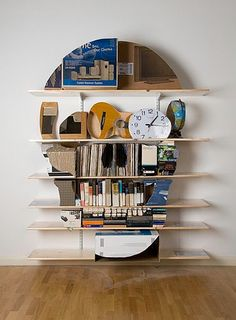 Skull bookshelf sculptures by James Hopkins crafts