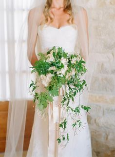 Catriona wore a sophisticated lace Monique Lhuillier gown and carried a cascading bouquet of English garden roses and greenery. Photography: Elizabeth Messina. Read More: http://www.insideweddings.com/weddings/catriona-mcginn-and-mark-paul-gosselaar/428/