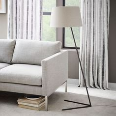 Less is more. The Petite Shade Floor Lamp's streamlined shape fits seamlessly even in small spaces. Its slim, V-shaped base makes it easy to slip under sofa legs or side tables.