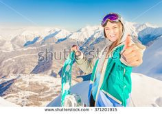 Snowboard. Inspired sport girl. Female snowboarder on the background of high snow-capped Alps in Swiss. Success gesture. Achieve.