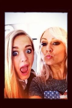 Lottie  Lou (: they look nothing like louis??? even though theyre his step sistersUMMM IF U WERE A REAL DIRECTIONER YOU WOULD KNOW THAT LOU IS NOT LOUIS STEP SISTER!!!!