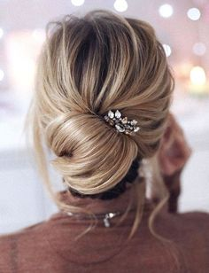 In love with this gorgeous chignon! With its soft-swept feel and loose structure, its as romantic as it gets. sexyhair.com