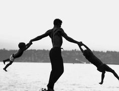 Dancer Jacques D'Amboise plays with his children near his home in Washington state, 1962.