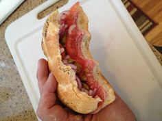 """This is a """"Hard Bread Sandwich."""" My dad used to make them for me and him EVERY Saturday afternoon. I began making them for my son. It's the best sandwich ever. Than you Dad! Hard Bread, Genoa Salami, Olive Salad, Best Sandwich, Food N, Food For Thought, Onion, Sandwiches, Red"""