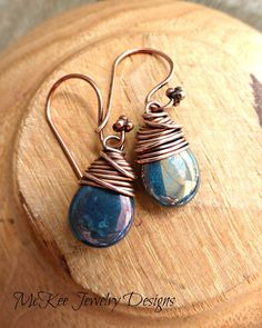 Blue and bronze shiny Czech glass teardrop and copper wrapped earrings. Small jewelry.