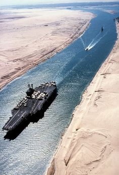 Suez Canal Crisis was when the Egyptian President, Abdul Nasser, creates a pact with Soviets. As a result the US pulls aid from the Dam Project. Egypt responds by closing Suez Canal. Bateau Yacht, Uss America, Navy Carriers, Navy Aircraft Carrier, Us Navy Ships, United States Navy, Battleship, Military Aircraft, World