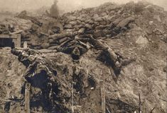 Dead British soldiers at a machine gun position on the Western Front in 1918 Picture: REUTERS/Archive of Modern Conflict London
