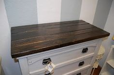 put boards on the top and stain if your dresser top is cracked or damaged.. genius!