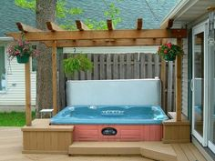Ground level deck with hot tub and pergola