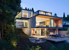 This Vancouver house by Canadian studio Splyce Design comprises a stack of glazed boxes set into a hillside, designed to maximise ocean views