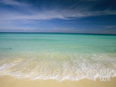 Clear Blue Water and Wispy Clouds Along the Beach at Cancun Photographic Print by Michael Melford at Art.com