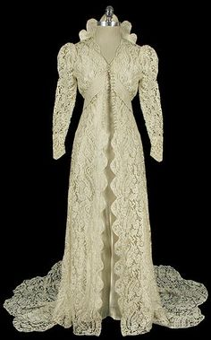 A lady from my work came in with a similar dress like this but it was from the 1800's. This is a 1930s Lace wedding dress