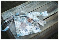 With our Cream Paisley Bow Tie, Pocket Square and Lapel Pin Set, you get a custom length self-tie cotton bow tie, 12.5 x 12.5 pocket square and a tan satin rose lapel pin. This set is an ideal gift for dads, husbands, groomsmen and more!/ $38 Satin Roses, Tie And Pocket Square, Esty, Lapel Pins, Gifts For Dad, Groomsmen, Headbands, Paisley, Dads
