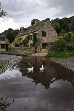 Duntisbourne Leer, Gloucestershire, England, where the ford almost laps the stone cottages
