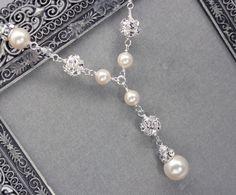 Pearl and Rhinestone Bridal Y Drop Necklace, Wedding Necklace for Sweetheart Neckline, Pearl Pendant Necklace. $63.00, via Etsy.