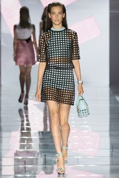"""Versace SS'15 MFW - Donatella said, """"This is about a fresh new Versace, one that is contemporary, clean and strong. It is the way women wear Versace now, and in the future."""" - LOVE this collection with little shifts, sporty knits, asymmetrical blocks of colour & rivets, buckles & studs - also bright and colourful optic prints of the house's Medusa motif and signature chains - overall there were too many great outfits to chose from...x"""