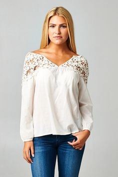 Natural colored 3/4 sleeve top with lace inserts at the yoke and shoulder. The Destiny Floral Top is a perfect Spring transition top that will look great with j