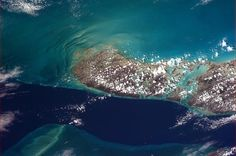 The deep waters of the 'Tongue of the Ocean' lick the reefs of Andros Island, the Bahamas.  from orbit