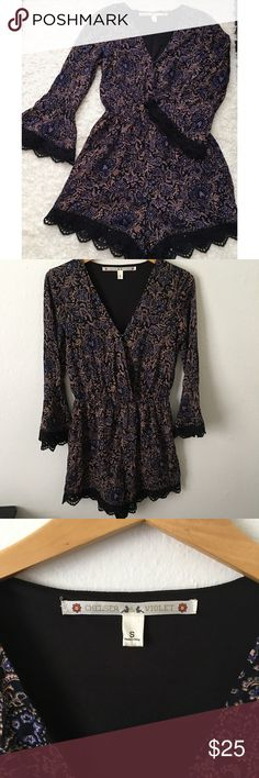 CHELSEA & VIOLET FLORAL ROMPER Gorgeous v-neck romper. Only worn once. Bell sleeves. Crochet lace lining. Elastic waist. No flaws. Chelsea & Violet Shorts