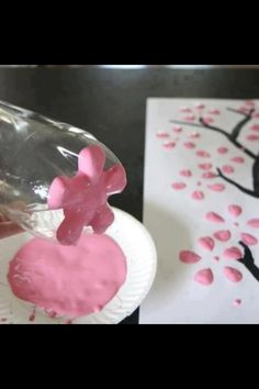 Creative art! With pink paint just dip the bottle in it to create the flowers!