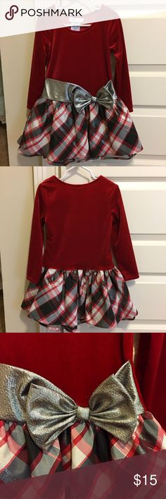Kids Holiday Dress Beautiful little girls holiday dress. Velvet red top with plaid, triple layered bottom (inner black slip, tulle middle layer, and outer fabric layer). The bow is sparkly silver. Worn once and in perfect condition! Size 4. Bundle 2 or more items and save 10% plus combined shipping! Bonnie Jean Dresses Formal