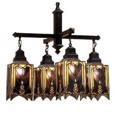 Like Primitive Folk Art, This Beautiful Chandelier Is Majestic In Its Simplicity. Created From Dusky Mauve, Olive And Honey Art Glass, And Accented With Clear Glass Jewels, The Shades Are Suspended From Hardware Hand Finished In A Warm Mahogany Bronze.