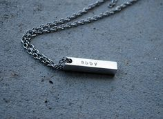 Aluminum and stainless steel. A masculine necklace perfect for Fatgers Day $25