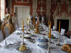 Authentic table layout and food preparation, with servants assembled at the back and guests to the left. Zeilitzheim from Munich rococo: 18th century