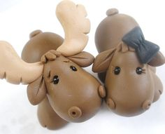 I Love everything about this one. But I'd want a little veil and Moose can have a top hat!   Moose Couple  Figures Cake Topper CAN BE by KenzCreations on Etsy, $45.00 @Erika Valenzuela