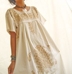 mexican embroidered dress, white and gold.