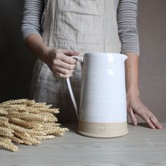 SIMPLE AND TACTILE, THIS sturdy PITCHER IS useful at the table or for decorating…