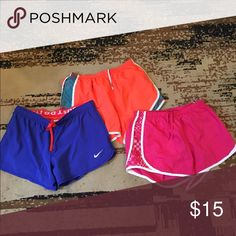 Nike Lot of three shorts The orange and blue are both Nike size medium and the pink pair is pony brand and is also medium in good condition. Nike Shorts