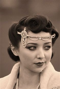 or hair like this... with the beautiful head piece. I can't tell if it's 50s or 20s, but I like it!