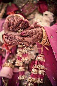 This picture holds so much meaning into it. I mean hands full of henna and jewelry, wearing really heavy outfit, garlands and garlands and a slight smile on her face and tears in her eyes. From now on she is not Single anymore, she isn't alont anymore. She is married. Someone's wife. Someone's companion.She starting a new chapter in her life and letting go of the past with a smile on her face (: