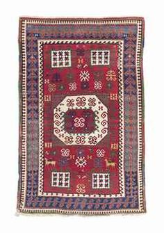 A KARATCHOPF KAZAK RUG -   SOUTH CAUCASUS, CIRCA 1870 -   A few short crease lines, naturally corroded brown, a couple of spot surface marks, otherwise good condition  8ft.1in. x 5ft.2in. (246cm. x 157cm.)