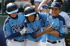 Las Vegas' Dominic Clayton, center, celebrates with teammates Josh Zuehlsdorff, left, and Dillon Jones after hitting a two-run home run off Chicago pitcher Cameron Bufford during the fourth inning of a baseball game in United States pool play at the Little League World Series tournament in South Williamsport, Pa., Sunday, Aug. 17, 2014. Las Vegas won 13-2
