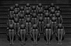 Misha Gordin - crowd on stairs with geometric patterns