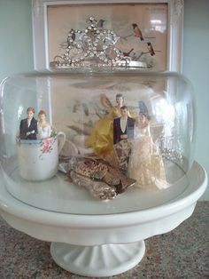 Cute way to display vintage cake topper collection.
