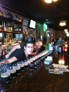 Purkey and Jess pouring some goodness