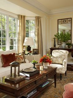 A sofa or loveseat set into a bay window makes for a seating area full of warmth and light  Timothy Corrigan