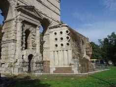 The Porta Maggiore marks the spot on the east side of the city where several aqueducts came into Rome. The top of the gate carried the Aqua Claudia and the Aqua Anio Novus. Its construction is characterized by rusticated masonry of travertine, a favored technique and material of the emperor Claudius, who dedicated the structure in 52 CE. In the third century, the monument was built into Rome's Aurelianic wall circuit and became a proper citygate. In front: the Tomb of the Baker Eurysaces.