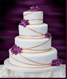 cakes effortless elegance this wedding cake is decorated with purple ...