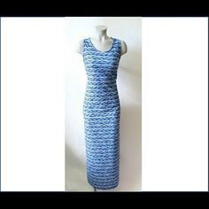"NWT Blue multicolored textured maxi dress sz L NWT Blue multicolored textured maxi dress sz L. Dress features a wavy pattern to the fabric Pull over style dress 96% polyester 4% spandex. Dress is not lined and is see thru if held up to a light. Dress measures 57"" Long. ECI Dresses Maxi"