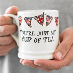 'You're just my cup of tea'. Our ceramic mugs are designed by us in London and lovingly handmade in Stoke-on-Trent, in the heart of the Potteries, using only the finest Cornish clay. Each mug has 'Lovingly handmade in England' inscribed into the base. Available plain or with our Union Jack bunting design, this mug has a lovely classic shape.The finest Cornish clay. Dishwasher safe.Width 8.5cm (exc handle), Height 9cm